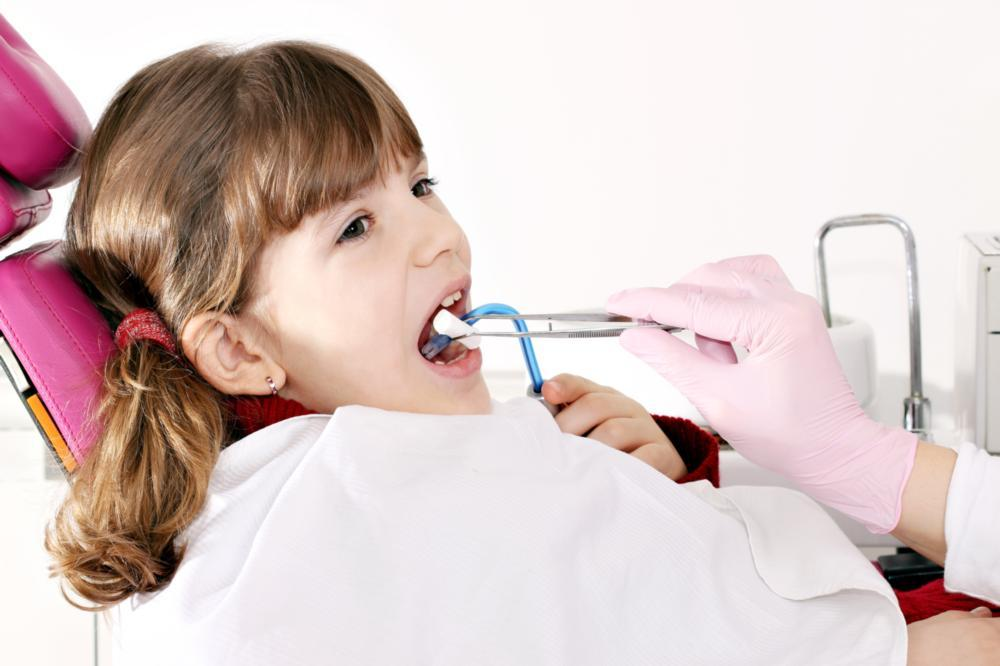 Pediatric Dentist Metairie LA | A young girl sits in the dental chair