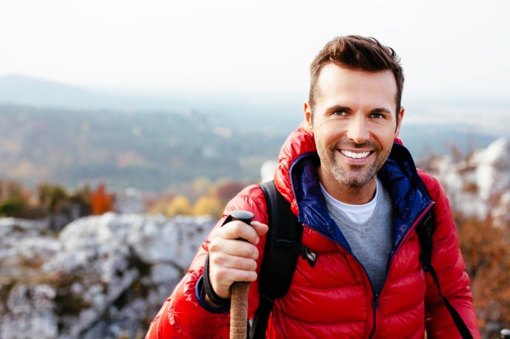 A Man Smiles as He's Hiking | Restorative Dentistry Metairie LA