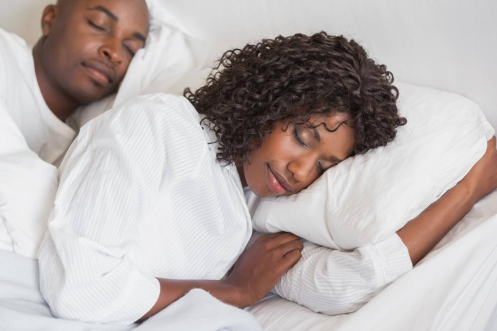 A woman rests peacefully in bed | Metairie LA Sleep apnea treatment