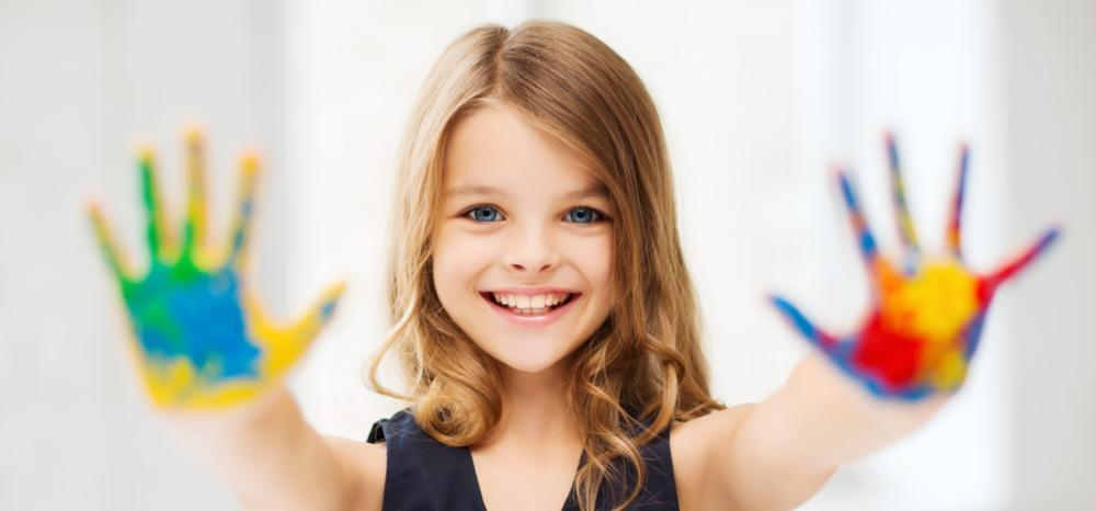 child with hand paint | childrens dentistry metairie la