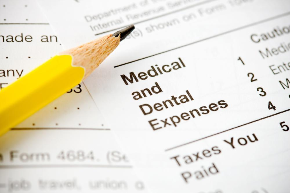 Dental Insurance Metairie LA | A Pencil on top of insurance papers.