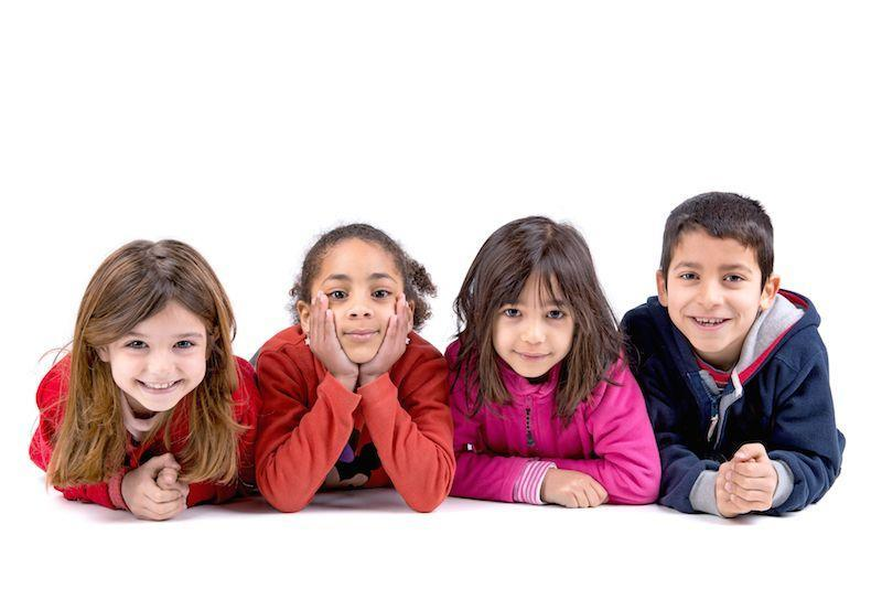 A Group of Children Smile on A White Background | Children's Dentistry Metairie LA