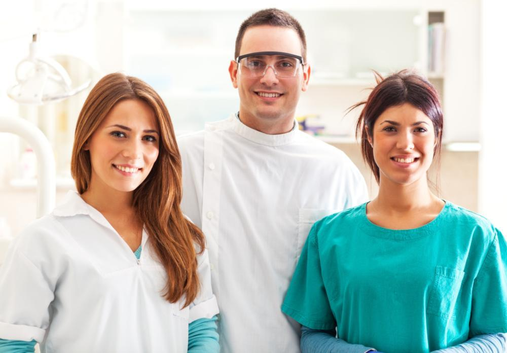 A dental team stands and smiles in a dental practice | Metairie LA Dentist