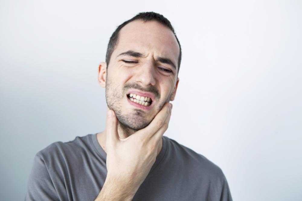 man suffering from a toothache in metairie