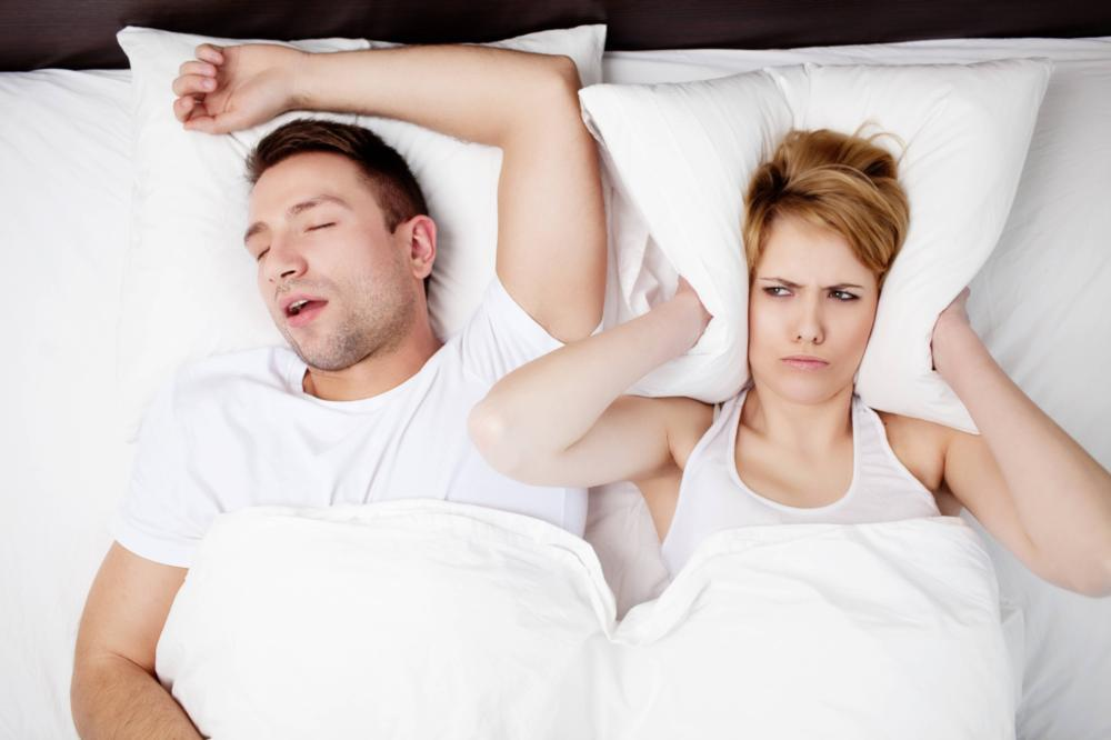 person snoring in bed | sleep apnea treatment metairie la