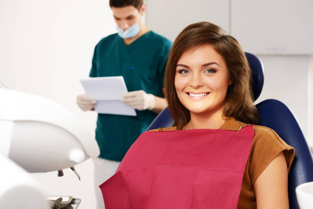 A woman smiles in the dental chair | Metairie LA dental extractions