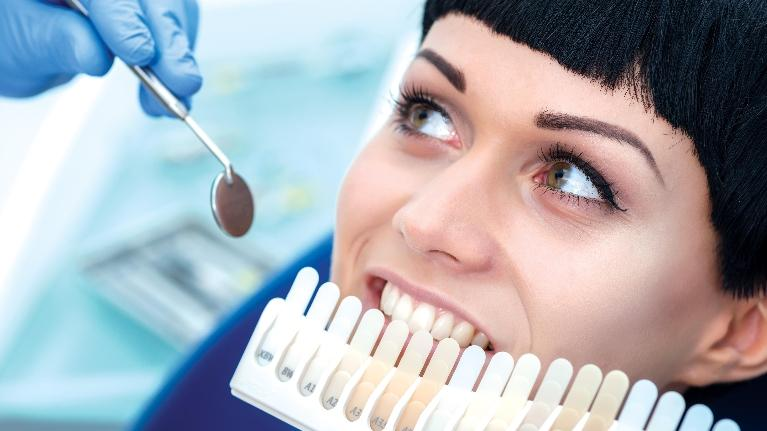 A woman gets her teeth whitened | Teeth Whitening in Metairie LA