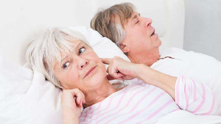 a woman plugs her ears because of her husband's snoring | sleep apnea treatment metairie