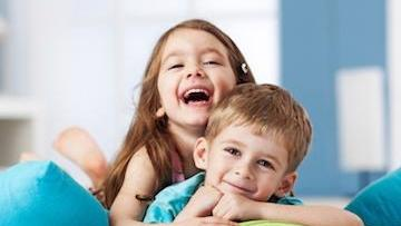 Two children smile at the camera | pediatric dentistry Metairie LA