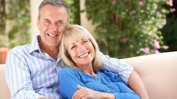 older couple smiling | dentures metairie
