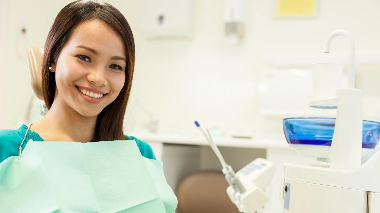 Woman Smiling in Dentist's Chair | Metairie Dentist