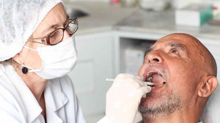 A man gets his teeth examined | Dentist in Metairie