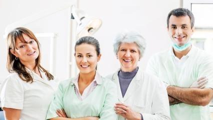 A group of medical professionals smiles | dentist metairie LA