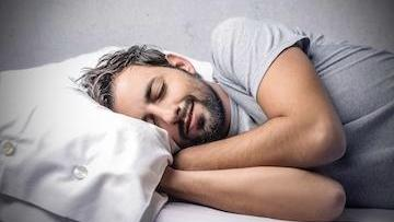 A man sleeps happily | sleep apnea metairie LA