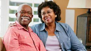 A couple smiles in their house | dentures metairie la