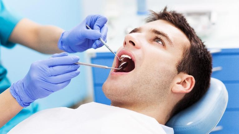 A man gets his teeth examined | Dentist Metairie LA